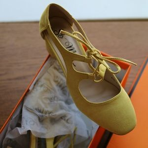 Mustard colored, faux suede lace-up heel.